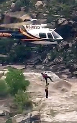 Rescuer clung to boy plucked from Arizona flash flood