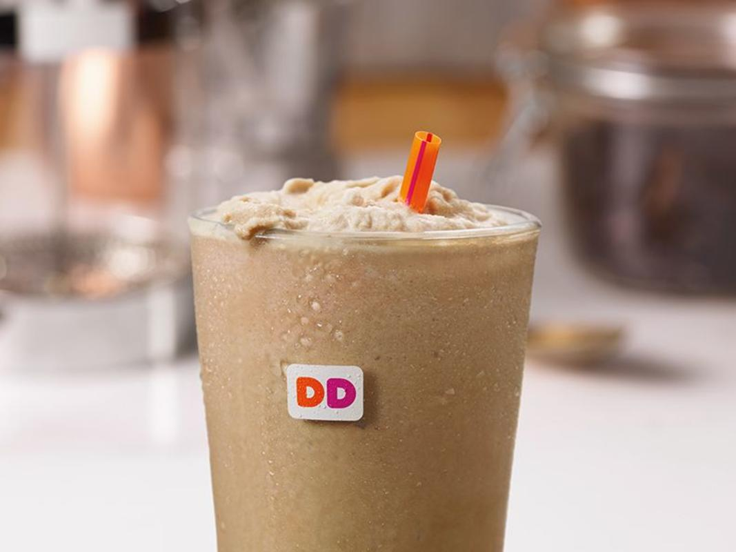 Dunkin's US customer traffic slows, expansion plan trimmed