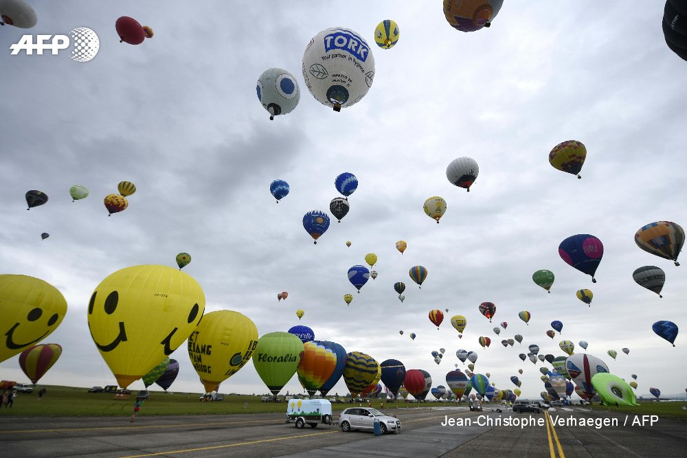 Dozens of hot air balloons take to the sky at Chambley-Bussieres airbase, near Hageville, eastern France