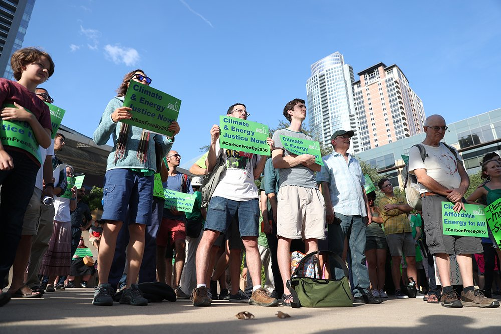 About 100 protesters call for Austin to end fossil fuel use for power