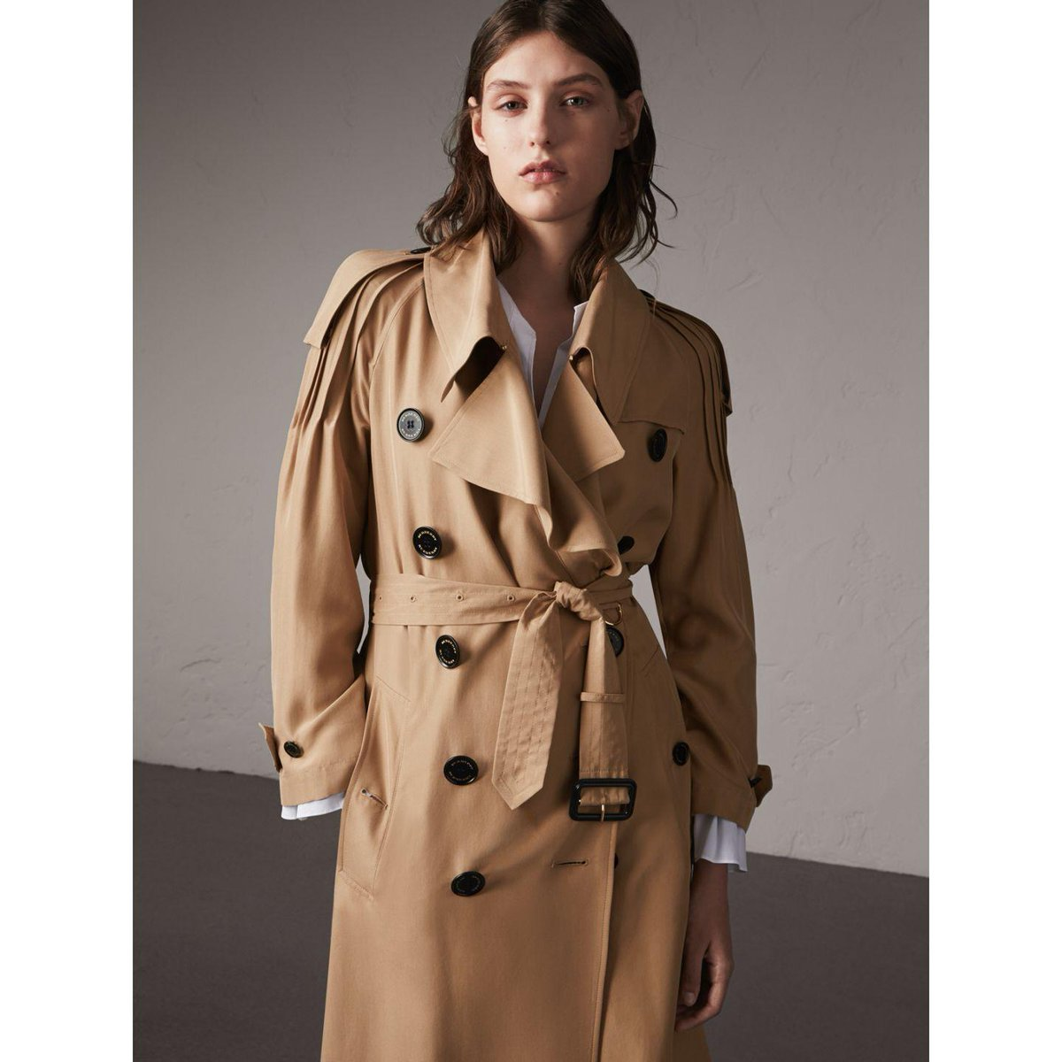 An oversize @Burberrytrench coat with ruffle detail. Shop the look...