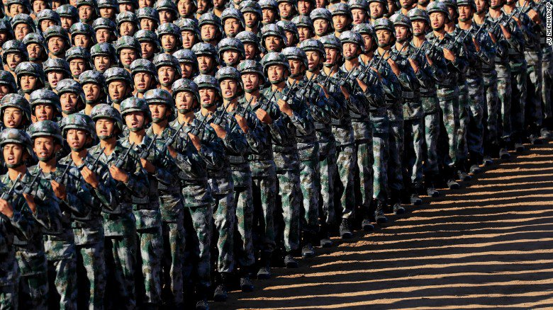 China shows off newest weapons in huge military parade