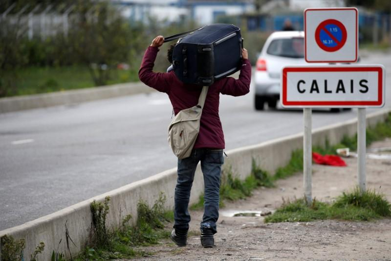 France to set up migrant centers outside Calais after court ruling