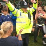 'Dad dancing' police officer having a bop at a music festival wins legion of fans