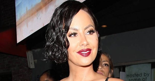 Amber Rose is barely recognizable in her black wig: