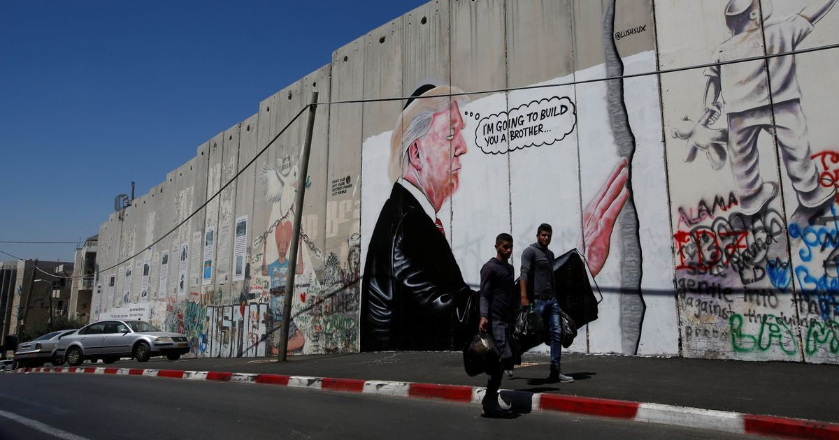 Banksy on the West Bank: Donald Trump graffiti resembling work of street artist daubed on Israeli's security barrier
