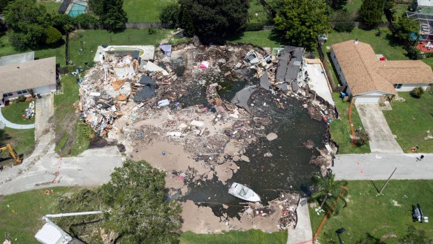 Banks collapse near sinkhole that swallowed Florida homes