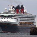Disney's Magic cruise liner stops for four hours to help migrants stranded on a tiny vessel in the Med