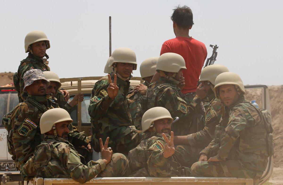 Shiite militia blames U.S. for attack that killed dozens on the Syria-Iraq border