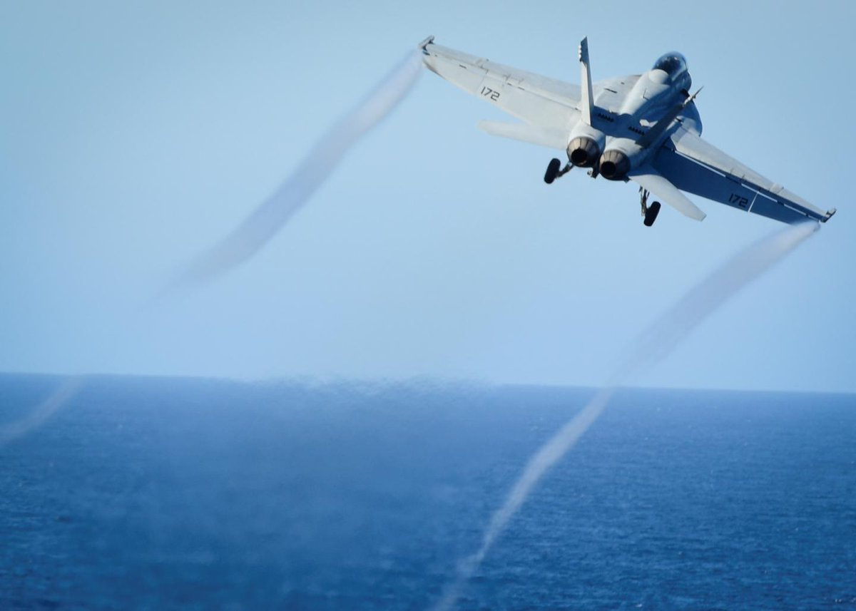 An Iranian drone buzzes a U.S. Navy F/A-18 jet in the Persian Gulf, forcing evasive action