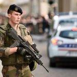 Suspect arrested after car rams Paris anti-terror troops