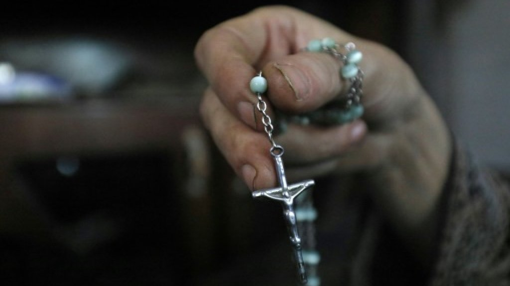 Rosary in hand, Christians flee Syria's IS-held Raqa