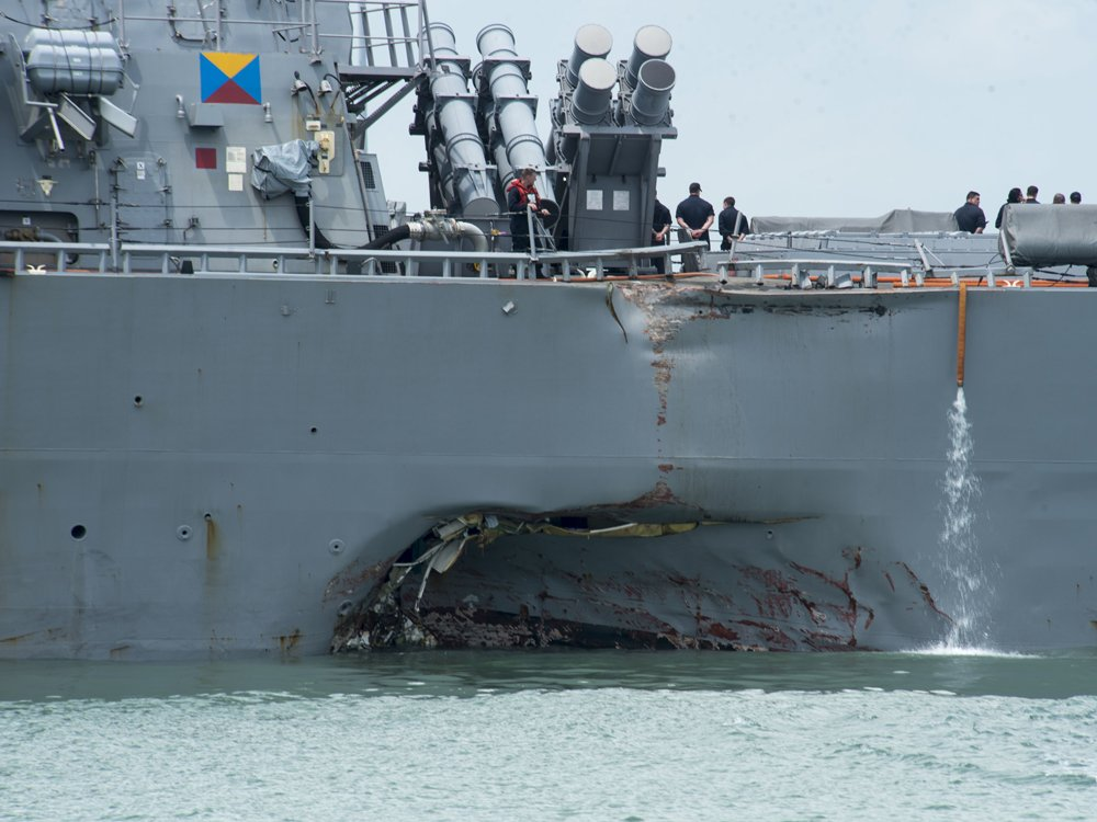 Remains of some sailors found on U.S. Navy destroyer damaged in collision with oil tanker