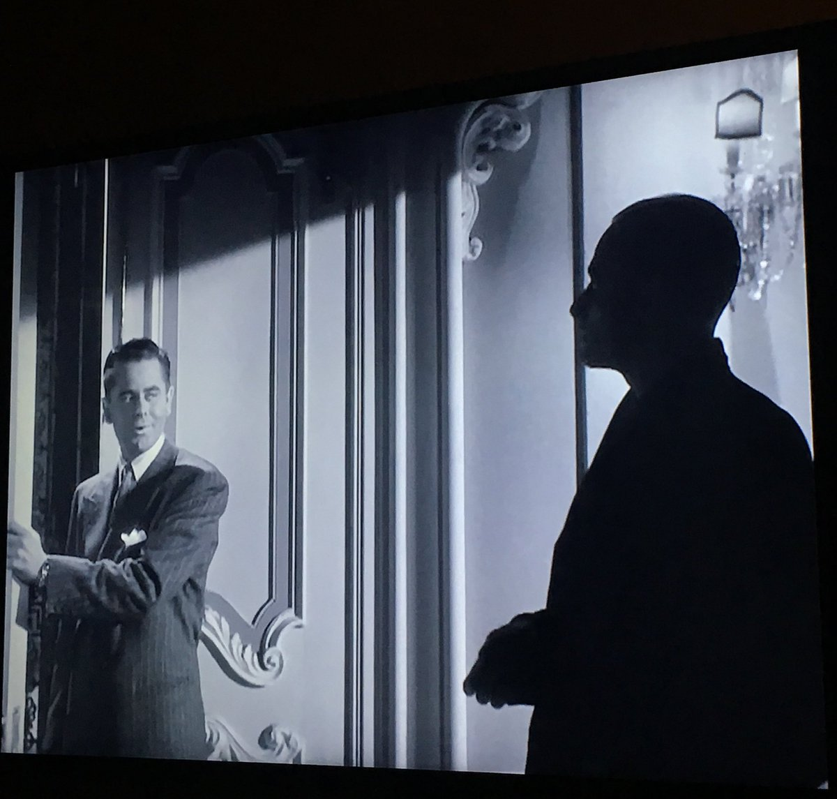 The light illuminates Johnny while a heavy shadow casts itself upon Mundson and holds tightly. #TCMParty #Gilda https://t.co/6z0vepPmsW