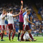 Burnley stun nine-man Chelsea, Huddersfield go top