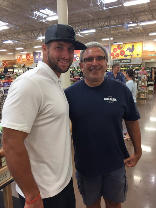 Today\s my dad\s birthday and he met Tim Tebow at the grocery store AND look how happy he is