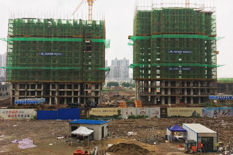 China July property investment, sales slow as curbs continue to bite