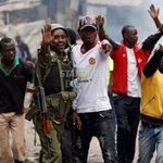 AP officer reasons with protestors in Mathare