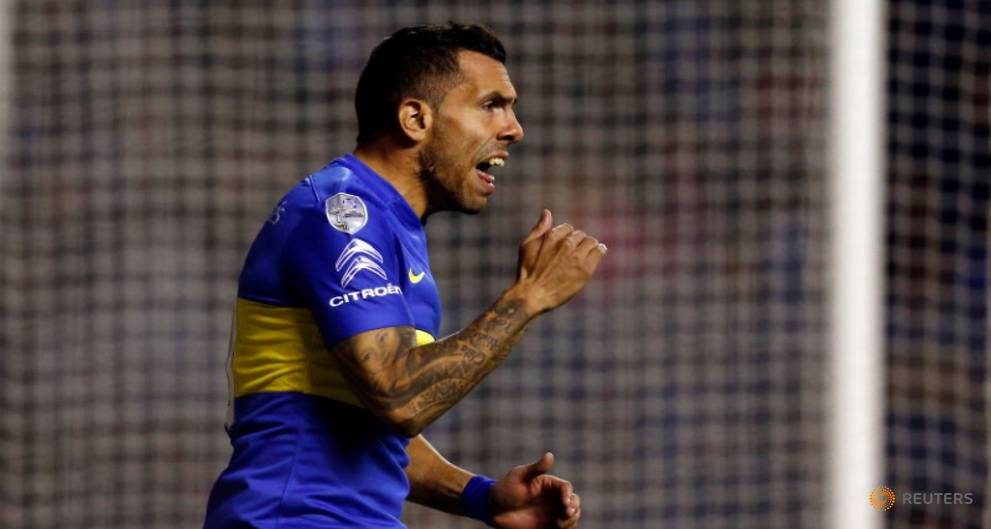 Soccer - Injured Tevez to return to China after Argentina treatment