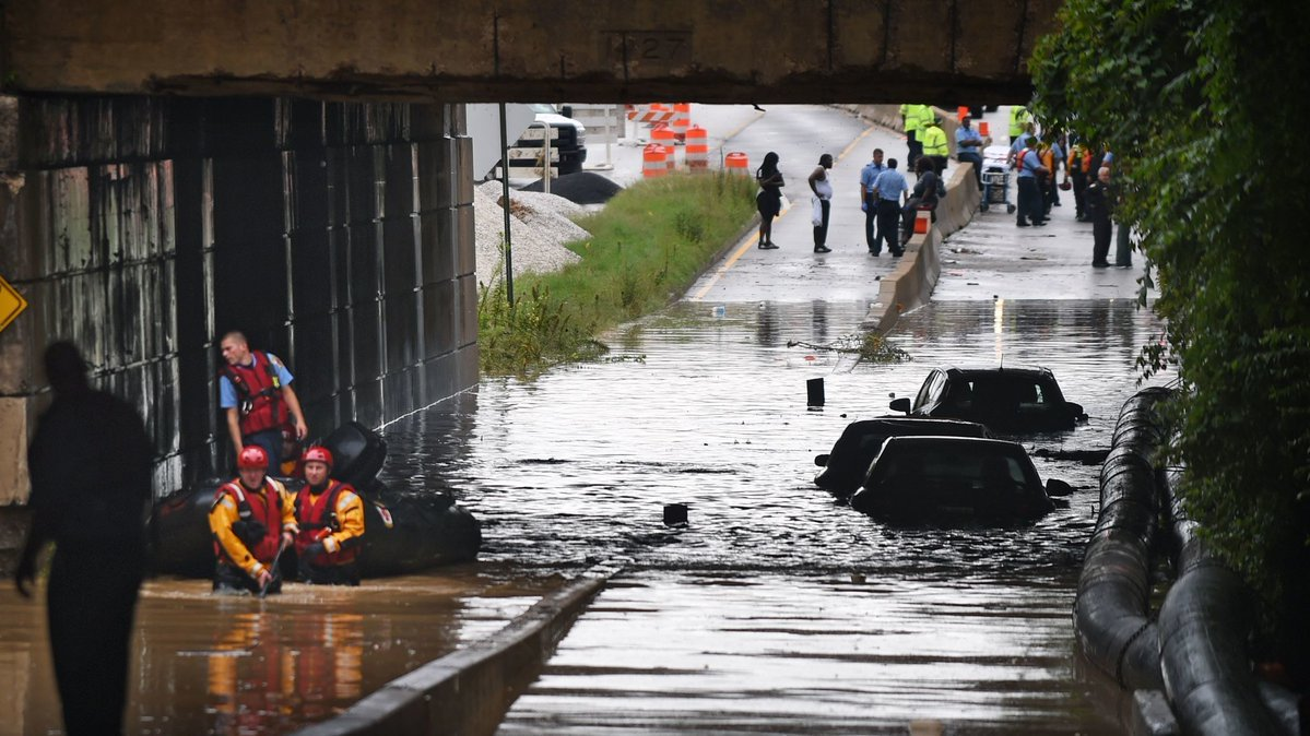 Driver rescued after car was submerged in Baltimore highway underpass