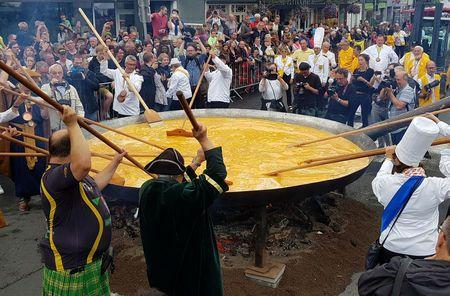 Belgian town cooks giant omelet amidst egg scare