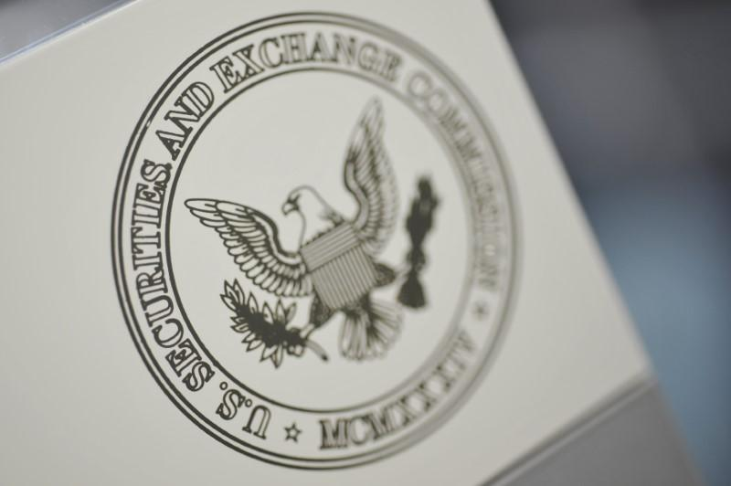 U.S. regulators charge bank employee, six others with insider trading