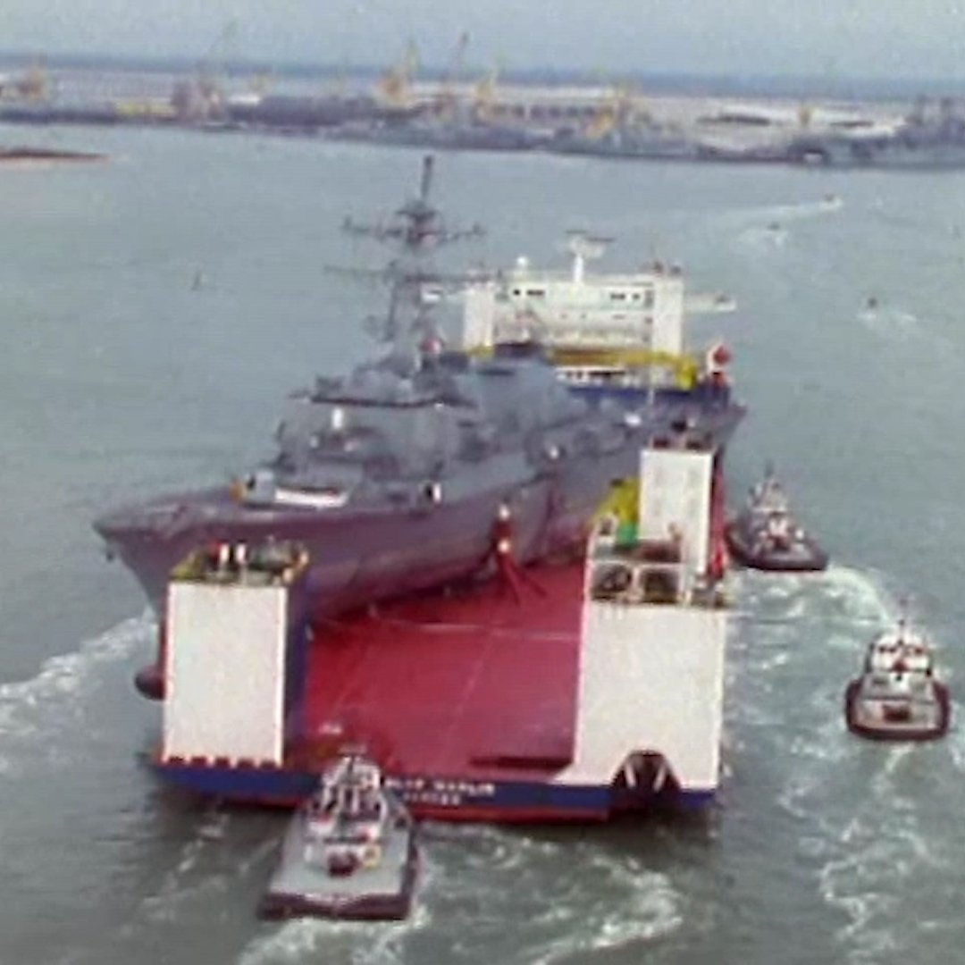 These huge vessels carry Navy ships around the world