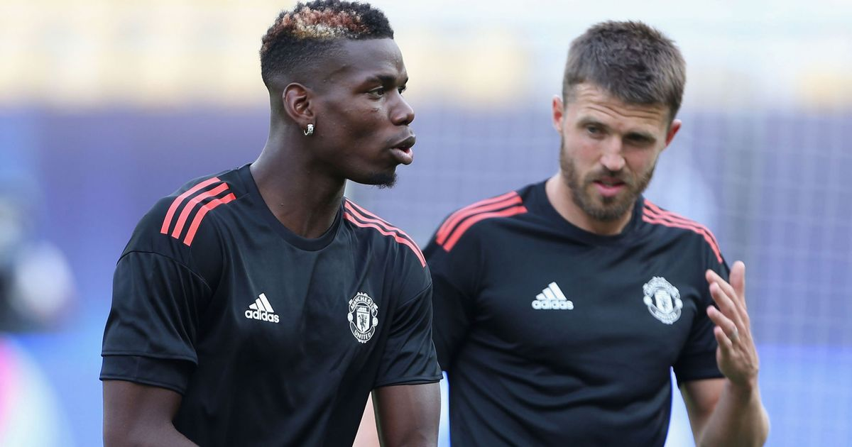 Manchester United captain Michael Carrick reacts to Reds omission
