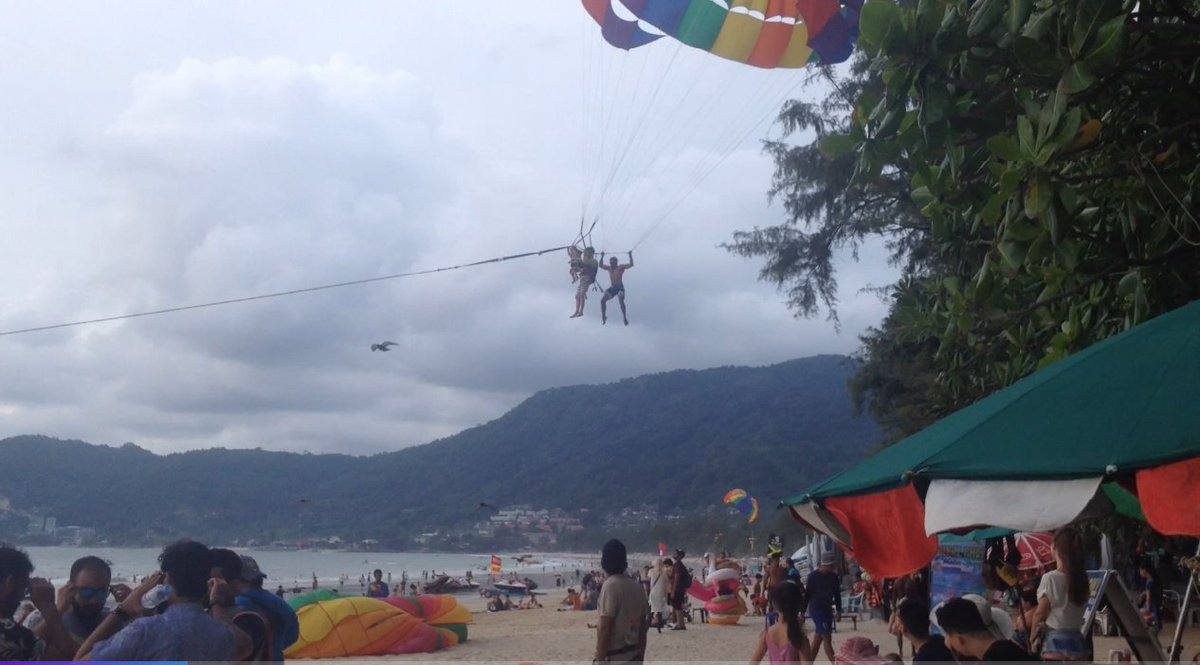 Shocking moment terrified toddler rescued while paragliding on Thai beach