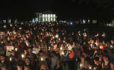 Hundreds gather for peaceful candlelight vigil at UVA in Charlottesville
