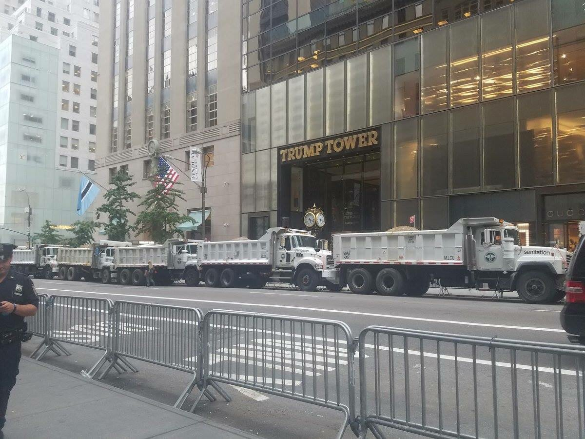 Trump Tower. Literally being protected by white trash trucks.  h/t Melissa Frank. https://t.co/gA4YZgs7Ee