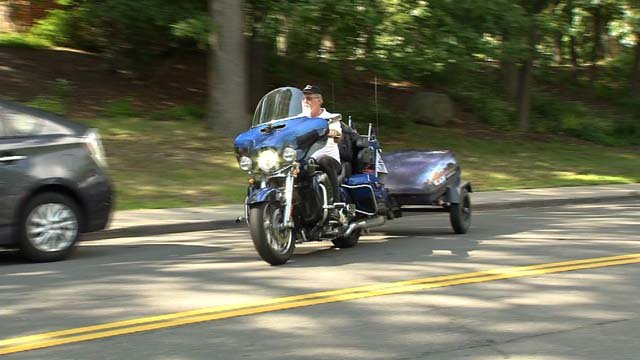 Man crosses country with motorcycle in memory of wife he lost to