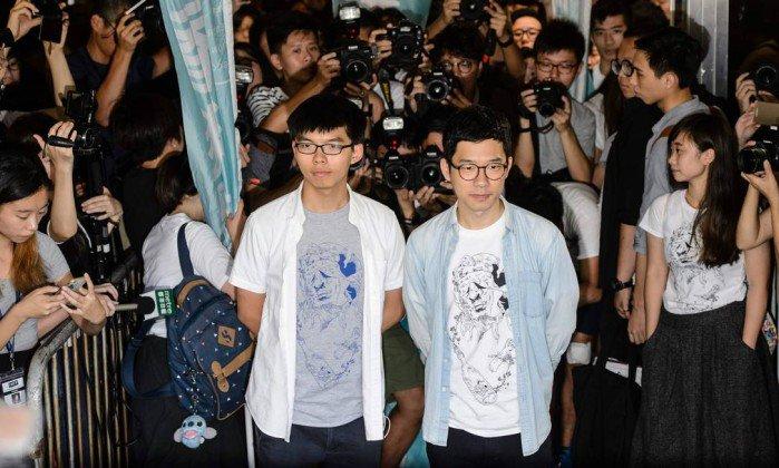 Hong Kong: Líderes da 'Revolução dos Guarda-Chuvas' são condenados à prisão