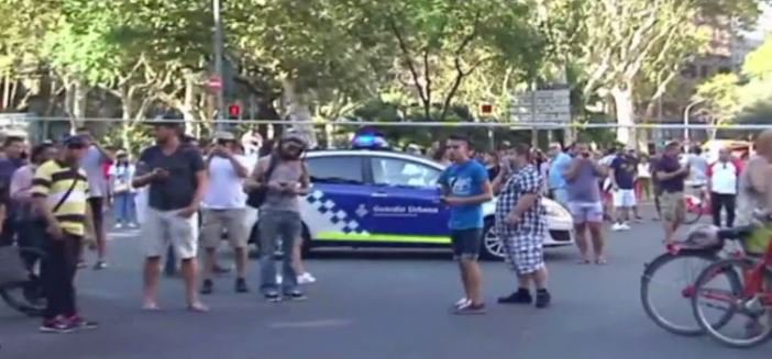 Attacker drives van into Barcelona crowd; at least 13 dead