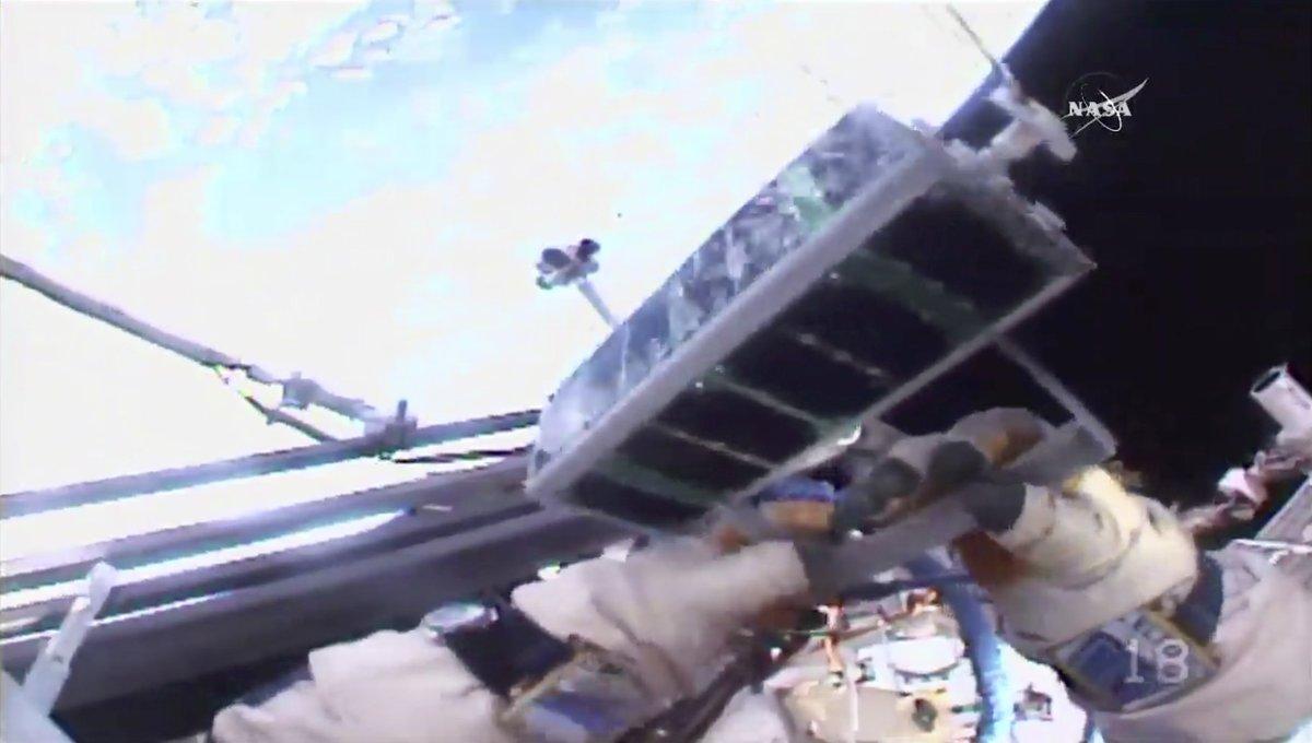 Spacewalking cosmonauts release 3-D-printed satellite