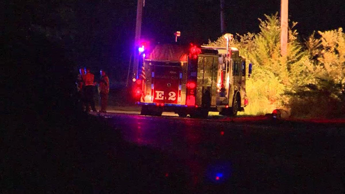 Man dies after car hits pole, rolls, catches fire