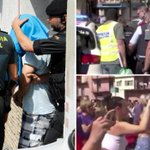 Moment angry crowd scream 'murderer' and 'pig' at hooded Barcelona terror suspect as he is led away by cops
