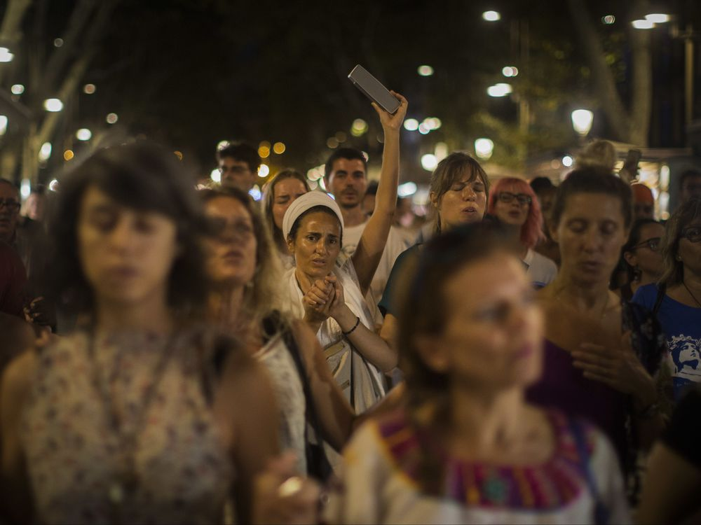 Death toll in Spain attacks rises to 15 after man found stabbed in car