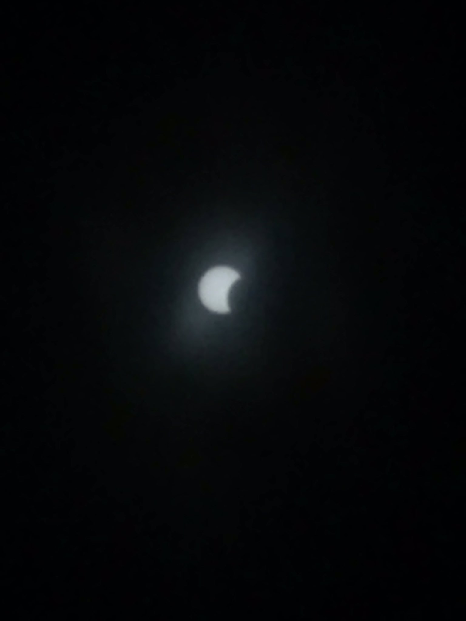 Eclipse starting in NYC. iPhone 10x zoom through my glasses, heh. https://t.co/kcdz5qpmuQ