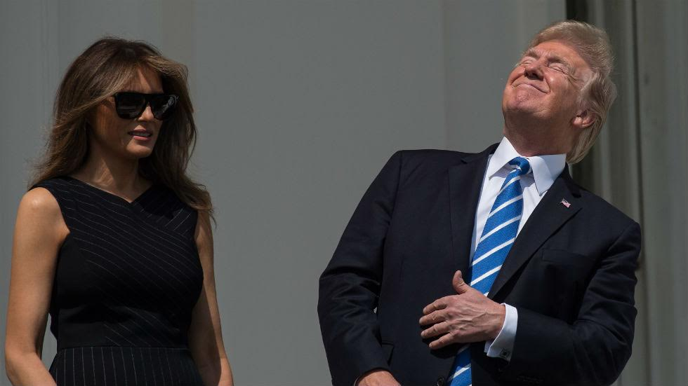 Trump looks up during eclipse without protective glasses https://t.co/6yjZqQJNMC https://t.co/sGrmv2Uy1g