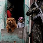 Brazilian military, police raid Rio's violent favelas but not before soldier tips off gangs