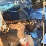 Musician serenades surgeons with saxophone while undergoing surgery to remove brain tumour