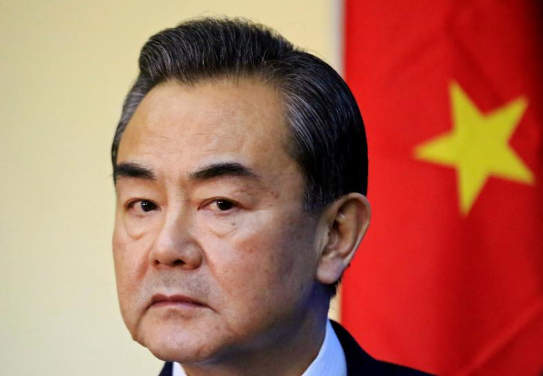 China's confident 'silver fox' steps into diplomatic limelight