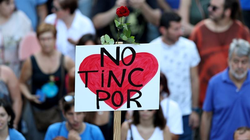 """""""I'm not afraid.""""  Spain unites for 500,000-strong Barcelona march"""