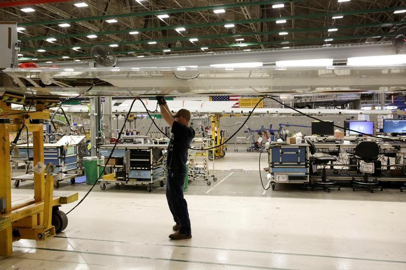 U.S. factory orders tumble, but business spending firming