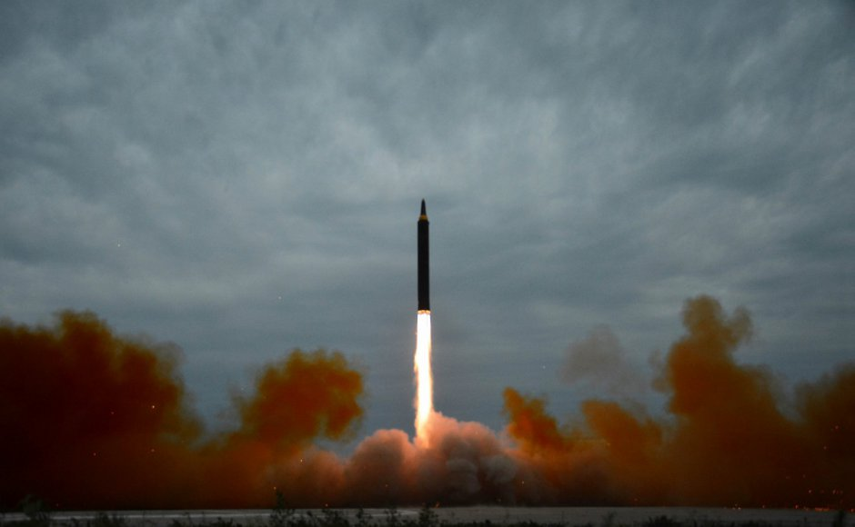 North Korea vows to hit Guam next, as UN condemns 'outrageous' missile launch