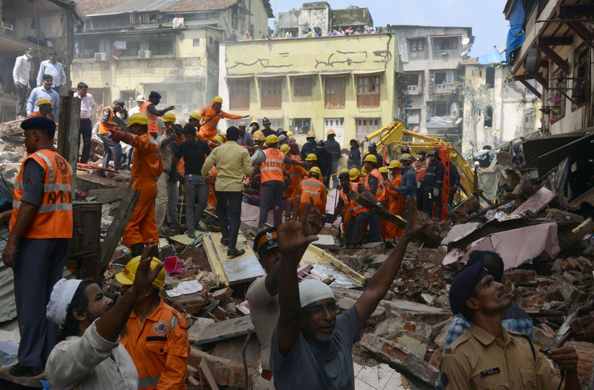 Deadly flooding in India has caused a four-storey building in Mumbai to collapse