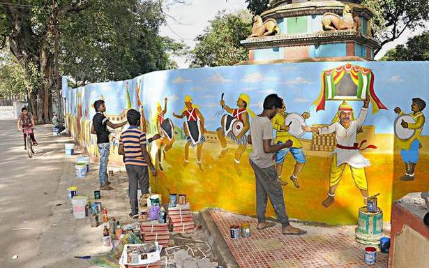 Artists, students decorating walls of government schools