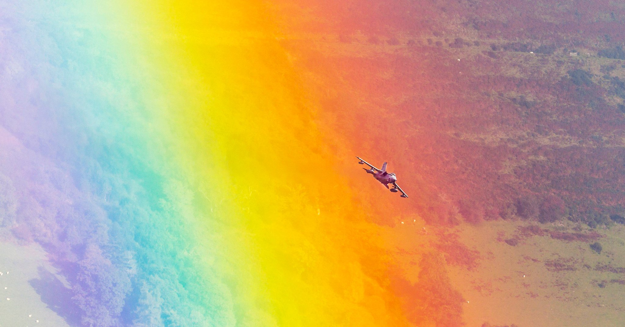 This is a picture of a fighter jet flying through a rainbow. Look at it. https://t.co/bfUNWVr8rv https://t.co/c5W2rjdojn