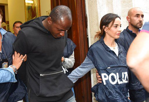 Italy police nab refugee as last suspect in beach gang rape